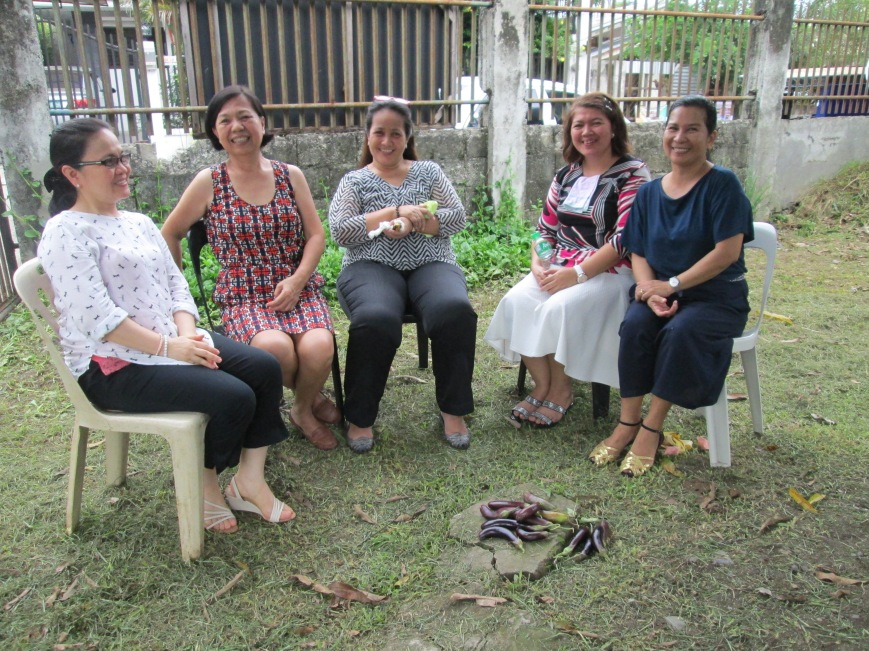 Women's Eggplant Fellowship: after picking ripe eggplant from the church garden